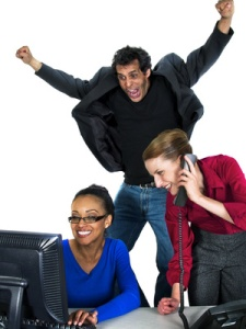 Image of employees celebrating a big win.