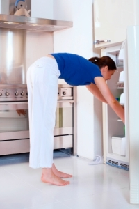 Alternate of women opening fridge.