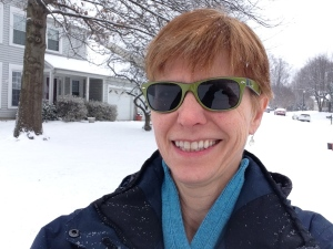Image of Marcia playing in the snow.