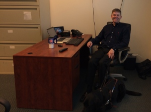 Picture of Eric Bridges takes a moment to relax in his office at ACB.
